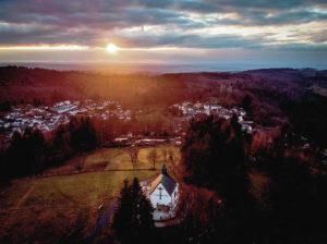 ASSOCIATED PRESS                                 The sun sets over the town of Oberreifenberg near Frankfurt, Germany.