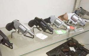STAR-ADVERTISER                                 Handguns were displayed for sale, in July 2018, at Honolulu Firearms & Range.