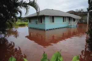 JAMM AQUINO / JAQUINO@STARADVERTISER.COM                                 A house on Haleiwa Road is surrounded by floodwater in Haleiwa.