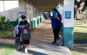 COURTESY HAWAII DEPARTMENT OF EDUCATION                                 Kaiulani Elementary Principal Jill Texeira welcomed younger students to campus with pompoms and music, while her staff dressed up and held signs to greet them.