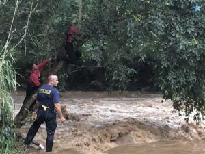 CRAIG T. KOJIMA / CKOJIMA@STARADVERTISER.COM                                 Rescue crews searched for a missing person, Tuesday, who was swept away into Waihona Stream in the Pearl City area.