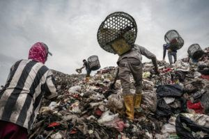 NEW YORK TIMES / FEBRUARY 28                                 Trash pickers search for recyclable plastic and other items of value at a landfill in Bantar Gebang, Indonesia.