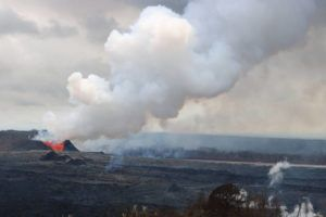 COURTESY USGS                                 A thick, dense plume of volcanic gases billows from lava fountains at fissure 8 in June 2018.