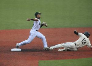 JAMM AQUINO / JAQUINO@STARADVERTISER.COM                                 Hawaii infielder Aaron Ujimori gets Long Beach State's Aidan Malm at second base and turns a double play for the final out during the ninth inning.