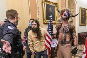 """ASSOCIATED PRESS                                 Supporters of President Donald Trump, including Jacob Chansley, right with fur hat, were confronted by U.S. Capitol Police officers, Jan. 6, outside the Senate Chamber inside the Capitol in Washington. The Capitol Police had clearer advance warnings about the Jan. 6 attack than were previously known, including the potential for violence in which """"Congress itself is the target."""""""