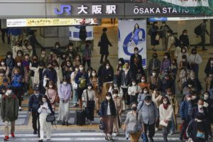 KYODO NEWS VIA ASSOCIATED PRESS                                 People wore face masks as they made their way in Osaka, western Japan Wednesday. Japan designated Osaka and two other areas for new virus control steps on Thursday as infections there rise less than four months before the Tokyo Olympics.