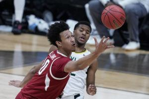 ASSOCIATED PRESS                                 Arkansas forward Jaylin Williams, left, fought for a loose ball with Baylor guard Jared Butler during the first half of an Elite 8 game in the NCAA men's college basketball tournament at Lucas Oil Stadium, March 29, in Indianapolis.