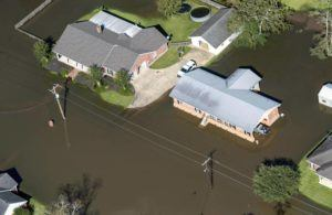 BILL FEIG/THE ADVOCATE VIA AP / 2020                                 Houses surrounded by floodwaters are seen in the aftermath of Hurricane Delta Saturday in Welsh, La. Hurricane Delta, which made landfall about 11 miles from where the devastating Hurricane Laura hit a little more than a month earlier, cost $2.9 billion in the United States and was linked to six deaths in the U.S. and Mexico, according to a report from the National Hurricane Center.
