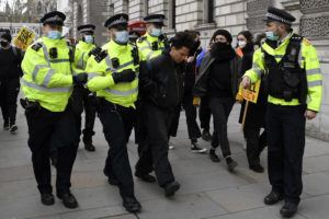 ASSOCIATED PRESS                                 Police detain a man for blocking traffic at Parliament Square during a 'Kill the Bill' protest in London on Saturday.