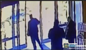 COURTESY OF NEW YORK POLICE DEPARTMENT VIA ASSOCIATED PRESS                                 An apartment building employee, center, closed the building's front door after a man assaulted a 65-year-old Asian American woman, March 29, a few blocks from New York's Times Square. Two New York City apartment building workers have been fired for failing to help an Asian American woman as she was being violently attacked on the sidewalk outside, the building's management company said today.