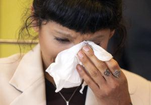 COURTESY HOUSTON CHRONICLE VIA AP                                 Ashley Solis, the first woman to file sexual assault claims against Houston Texans quarterback Deshaun Watson, wipes away tears while giving her statement during a news conference, today, in Houston.