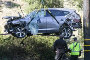 ASSOCIATED PRESS                                 A crane was used to lift a vehicle, Feb. 23, following a rollover accident involving golfer Tiger Woods, in the Rancho Palos Verdes suburb of Los Angeles. Woods was speeding when he crashed an SUV in Southern California less than two months ago, leaving the golf superstar seriously injured, authorities said today.