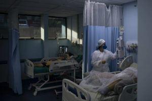 ASSOCIATED PRESS                                 COVID-19 patients were treated in the municipal hospital of Sao Joao de Meriti, Rio de Janeiro state, Brazil, Thursday.