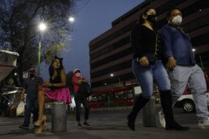 ASSOCIATED PRESS                                 Sex worker Geraldine, wearing cat make-up, sat on her usual corner as she waited for clients outside the Revolution subway station, in Mexico City, March 13. Geraldine, 30, a sex worker since age 15, says many of her regular clients have stopped coming amid the coronavirus pandemic and that seeing new clients presents new health and security risks.