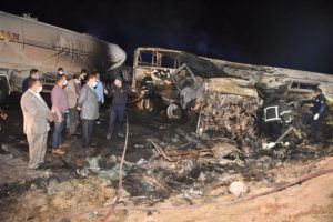 COURTESY ASSIUT GOVERNORATE MEDIA OFFICE VIA AP                                 Authorities work on the collision site where a bus overturned Tuesday, while trying to pass a truck on a highway in southern Egypt, near the city of Assiut, Egypt.