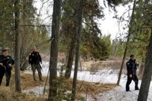 GALLATIN COUNTY SHERIFF'S OFFICE VIA AP                                 Officers from the sheriff's office and West Yellowstone Police Department are seen near the scene of a grizzly bear mauling just outside Yellowstone National Park near West Yellowstone, Mont. on Thursday.
