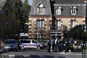ASSOCIATED PRESS / APRIL 23                                 Police officers gather next to the Police station in Rambouillet, southwest of Paris. A French police officer was stabbed to death inside her police station Friday near the famed historic Rambouillet chateau, and her attacker was shot and killed by officers at the scene, authorities said. The identity and the motive of the assailant were not immediately clear, a national police spokesperson told The Associated Press. The police officer was a 49-year-old administrative employee in the station, the spokesperson said.