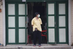 ASSOCIATED PRESS                                 A shop assistant wearing a face mask to help curb the spread of the coronavirus stood in front of her shop in Khao San road, a popular hangout for Thais and tourists in Bangkok, Thailand, Monda.