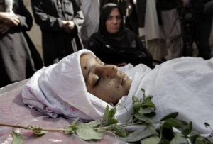 ASSOCIATED PRESS                                 Relatives surround the body of a 10-year-old Afghan girl who was killed by a roadside bomb, apparently targeting a group of soldiers, during her funeral on the outskirts of Kabul, Afghanistan, in 2013.