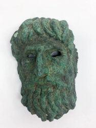 MANHATTAN DISTRICT ATTORNEY'S OFFICE VIA NEW YORK TIMES                                 A bronze mask of Silenus, circa 2nd Century.