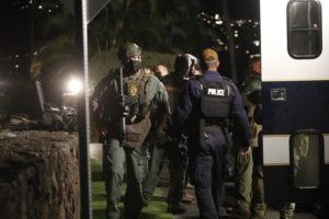 CINDY ELLEN RUSSELL / CRUSSELL@STARADVERTISER.COM                                 Honolulu Police Specialized Services Division responded to a barricade situation with an armed man at the Kahala Hotel on Saturday night.