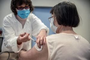 NEW YORK TIMES / MARCH 19                                 A patient receives the AstraZeneca coronavirus vaccine in Budapest, Hungary.