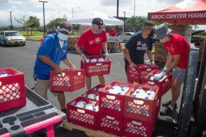 CRAIG T. KOJIMA / APRIL 30                                 Salvation Army's Kroc Center volunteers grab pallets of milk for distribution to 500 families facing food insecurity amid the coronavirus pandemic. Families receive fresh produce, milk and more.