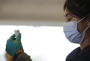 JAMM AQUINO / APRIL 27                                 Kalihi Palama Health Center registered nurse Alexis Lagasca readies a dose of Moderna COVID-19 vaccine at the Lanakila Multi-Purpose Senior Center in Kalihi.