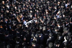 ASSOCIATED PRESS / APRIL 30                                 Mourners carry the body of Shragee Gestetner, a Canadian singer who died during Lag BaOmer celebrations at Mt. Meron in northern Israel, at his funeral in Jerusalem. A stampede at a religious festival attended by tens of thousands of ultra-Orthodox Jews in northern Israel killed dozens of people and injured about 150 others early Friday, medical officials said. It was one of the country's deadliest civilian disasters.
