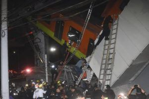 ASSOCIATED PRESS                                 Mexico City fire fighters and rescue personnel work to recover victims from a subway car that fell after a section of Line 12 of the subway collapsed in Mexico City, Monday.