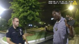 ASSOCIATED PRESS                                 In this June 12, 2020, file photo from a screen grab taken from body camera video provided by the Atlanta Police Department Rayshard Brooks, right, speaks with Officer Garrett Rolfe, left, in the parking lot of a Wendy's restaurant, in Atlanta. Former Atlanta Police Officer, Rolfe's attorney said Thursday, April 22, 2021, that his client didn't get a chance to defend himself before he was fired for fatally shooting Brooks, a Black man who had been running away from two white officers after he resisted arrest and fired a stun gun at one of them.