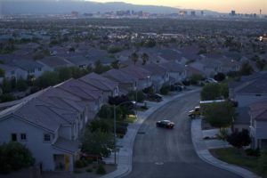 ASSOCIATED PRESS                                 The Las Vegas skyline glowed at dusk, in May 2013, as a motorist pulled into the driveway of a home, in Henderson, Nev. Home prices in the Las Vegas area are setting monthly records, according to an industry survey putting the median price of existing single-family houses at $375,000 in April.