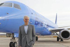 COURTESY CEANORRETT VIA AP                                 JetBlue creator David Neeleman poses next to a Breeze Airways aircraft.