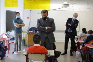 ASSOCIATED PRESS / APRIL 26                                 French President Emmanuel Macron talks with a pupil during a visit with French Education, Youth and Sports Minister Jean-Michel Blanquer, right, in a school in Melun, south of Paris.