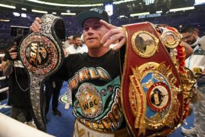 ASSOCIATED PRESS                                 Canelo Alvarez celebrates after defeating Billy Joe Saunders in a unified super middleweight world championship boxing match, Saturday, in Arlington, Texas.