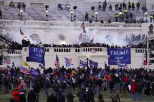ASSOCIATED PRESS / JANUARY 6                                 People storm the U.S. Capitol in Washington.