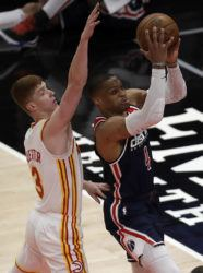 ASSOCIATED PRESS                                 Washington Wizards' Russell Westbrook shoots past Atlanta Hawks' Kevin Huerter during the first half of an NBA basketball game, today, in Atlanta.