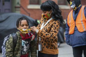 Andrew Rush/Pittsburgh Post-Gazette via ASSOCIATED PRESS                                 Jenea Edwards, of the North Side, helped her son Elijah, 9, in the third grade, with his mask before heading into Manchester Academic Charter School, March 29, on the first day of in-person learning via a hybrid schedule, in Pittsburgh. Dozens of school districts around the country have eliminated requirements for students to wear masks, and many more are likely to ditch mask requirements before the next academic year.