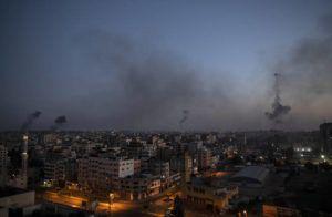 ASSOCIATED PRESS                                 Black smoke rise following Israeli airstrikes on Gaza City, today.
