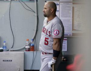 ASSOCIATED PRESS                                 Los Angeles Angels Albert Pujols leans on his bat in the dugout during the eighth inning of a baseball game against the Seattle Mariners on May 2 in Seattle.
