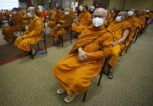 ASSOCIATED PRESS                                 Buddhist monks wait to receive Sinovac COVID-19 vaccines at Priest hospital in Bangkok, Thailand, Tuesday.