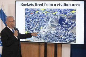 ASSOCIATED PRESS                                 Israeli Prime Minister Benjamin Netanyahu gestures as he shows a slideshow during a briefing to ambassadors to Israel at the Hakirya military base in Tel Aviv, Israel.