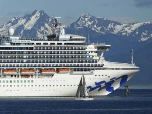 ASSOCIATED PRESS                                 A sail boat maneuvers near a large cruise ship near Juneau, Alaska, in 2018. Congress has voted to let large cruise ships sail directly from Washington state to Alaska without stopping in Canada, a step that could clear the way for cruises later this year.