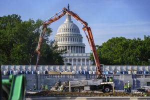 """ASSOCIATED PRESS                                 A concrete pump framed the Capitol Dome during renovations and repairs to Lower Senate Park on Capitol Hill in Washington, Tuesday. Prospects for an ambitious infrastructure deal were thrown into serious doubt late today after the White House reduced President Joe Biden's sweeping proposal to $1.7 trillion but Republican senators rejected the compromise as disappointing, saying """"vast differences"""" remain."""