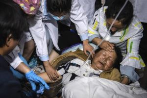 HU CHAO/XINHUA VIA AP                                 Medical workers treat a woman after an earthquake in Yangbi Yi Autonomous County in southwestern China's Yunnan Province, early Saturday, May 22. A pair of strong earthquakes struck two provinces in China overnight on Saturday.