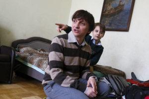 ASSOCIATED PRESS                                 Volodymyr Yavorskyy and his son, Danila, speak to journalists in Kyiv, Ukraine, on Friday.