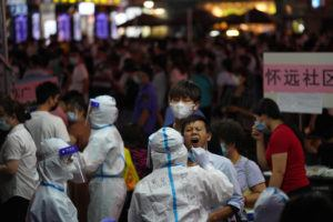 ASSOCIATED PRESS                                 A resident gets tested for coronavirus in the Liwan District in Guangzhou in southern China's Guangdong province on Wednesday.