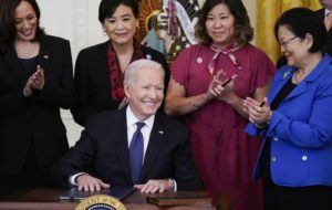 ASSOCIATED PRESS                                 President Joe Biden smiled after signing the COVID-19 Hate Crimes Act, in the East Room of the White House, today, in Washington. Top row from left, Vice President Kamala Harris, Rep. Judy Chu, D-Calif., Rep. Grace Meng, D-N.Y., and Sen. Mazie Hirono, D-Hawaii.
