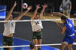 ASSOCIATED PRESS                                 Hawaii's Patrick Gasman, left, and Colton Cowell attempt to block a shot from BYU's Gabi Garcia Fernandez (5) during the NCAA men's volleyball championship match today in Columbus, Ohio.