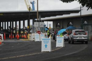 JAMM AQUINO / JAN. 18                                 Vehicles drive up at the first mass COVID-19 vaccination clinic at Pier 2 on Jan. 18 in Honolulu. More than 1.26 million vaccine shots have been administered in Hawaii through state and federal distribution programs.